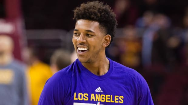 Nick Young narrowly avoids firework accident - IMAGE