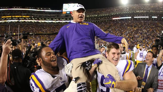 Superfan? TV show narrator? Thinking of a few jobs for the charismatic Les Miles until a new coaching job arrives