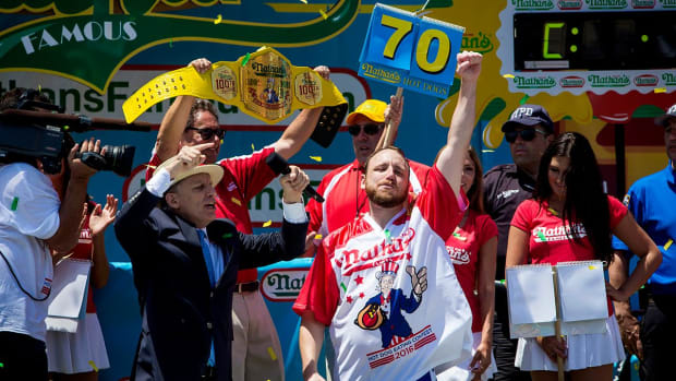 Joey Chestnut downs 70 hot dogs to reclaim title -- IMAGE
