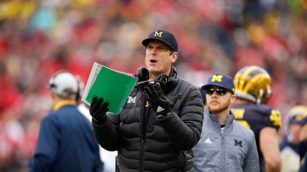 Michigan coach Jim Harbaugh rips recent satellite camp vote: 'I suggest we drop the term student-athlete'