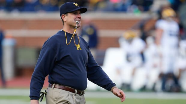 jim-harbaugh-ncaa-satellite-camp-ban-sec.jpg