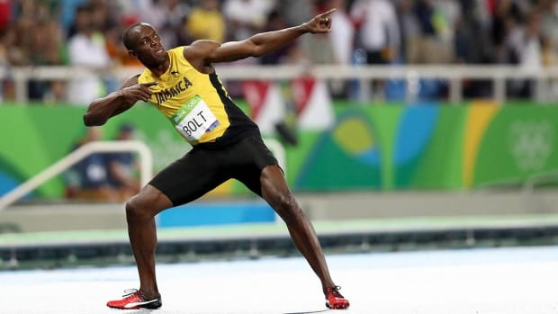 Usain Bolt sprints to 200m Gold, Olympic history - IMAGE