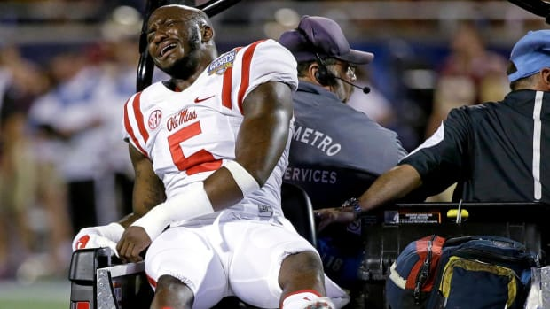 Ole Miss CB Ken Webster carted off with apparent knee injury - IMAGE