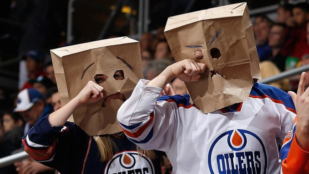 edmonton-oilers-fan-drivers-license-hat-religious-equality.jpg