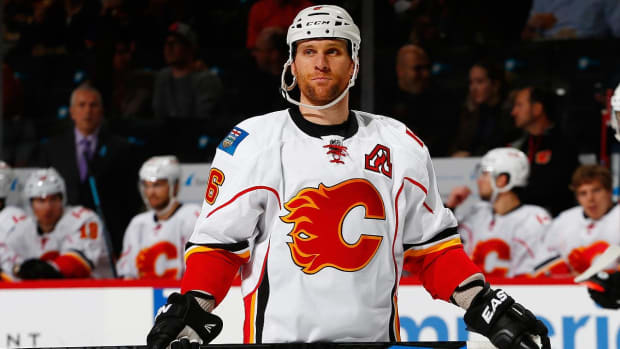 Flames' Wideman suspension reduced on appeal from 20 to 10 games--IMAGE