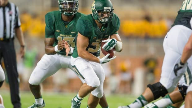 Once homeless and declared ineligible to play college football, Silas Nacita keeps his dream of going pro alive