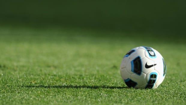 soccer-cheerleader-tackles-captain.jpg