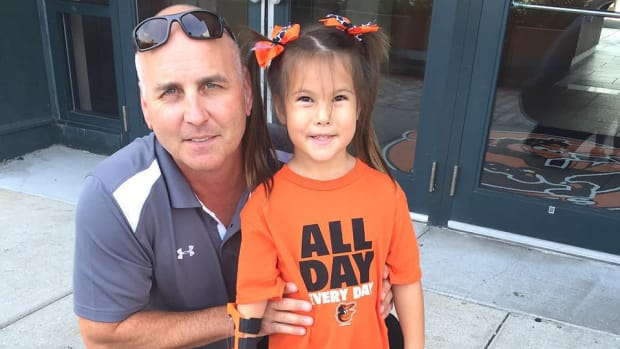 baltimore-orioles-girl-robotic-hand-first-pitch-video.jpg