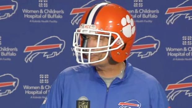 Rex Ryan wears a Clemson helmet to a press conference - IMAGE