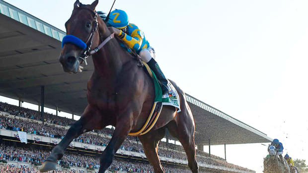 american pharoah belmont stakes triple crown.jpg