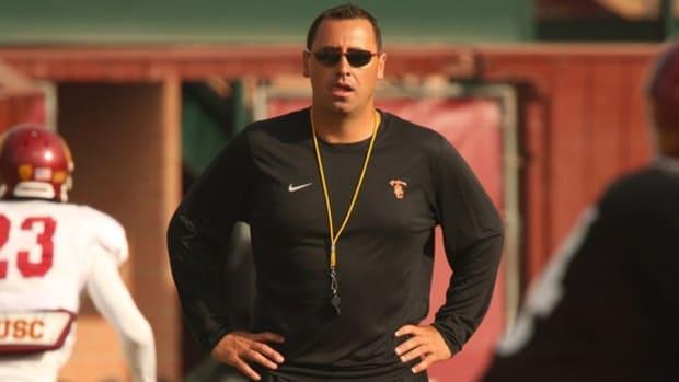 Why is bachelorhood so uncommon among college football head coaches?