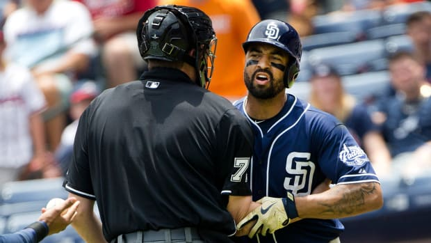 Padres right fielder Matt Kemp tackled by umpire