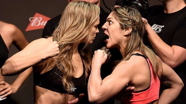 Bethe Correia gets in Ronda Rousey's face at UFC 190 weigh-in--IMAGE