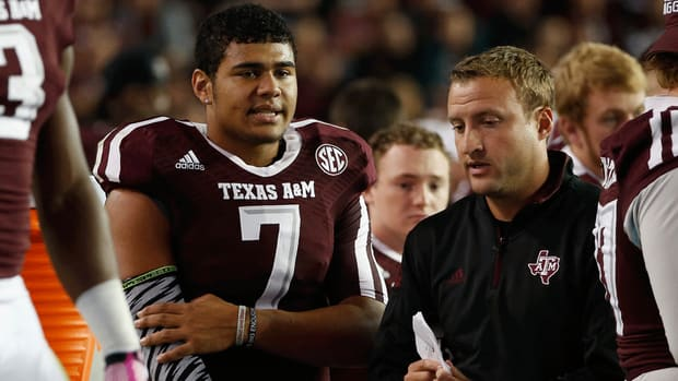 Texas A&M QB Kenny Hill's father denies that son has committed to TCU