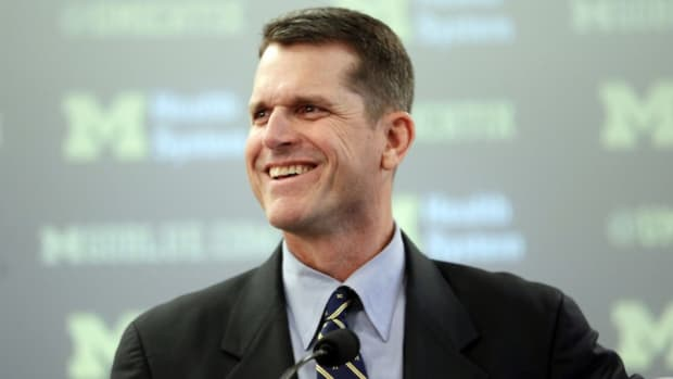 Watch: Harbaugh hangs in Michigan basketball student section - image