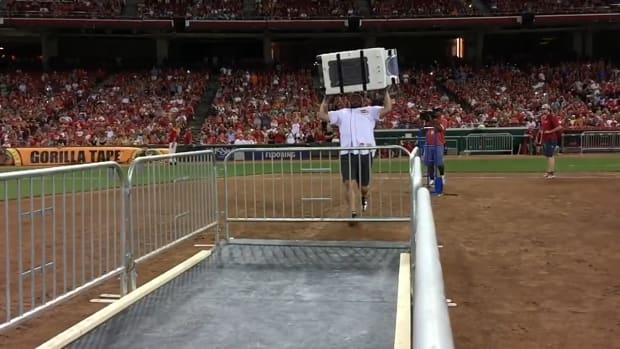 World record for washing machine toss set at Reds game--IMAGE