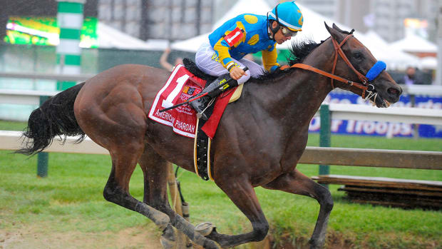 american-pharoah-wins-preakness-triple-crown.jpg