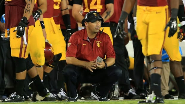 USC head coach Steve Sarkisian gives play-calling duties to OC Clay Helton--IMAGE