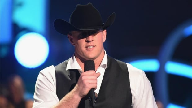 J.J. Watt met Arnold Schwarzenegger at CMT awards