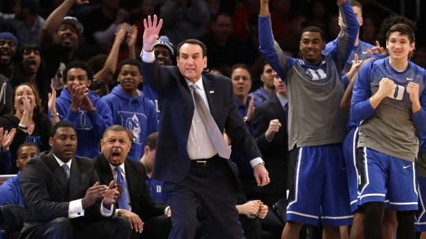Coach Mike Krzyzewski becomes first Division I coach to reach 1,000 career wins