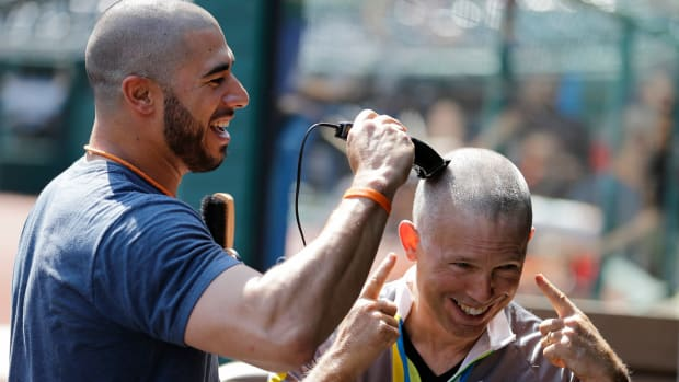 indians-owner-paul-dolan-shaved-head-mike-aviles-daughter-cancer.jpg