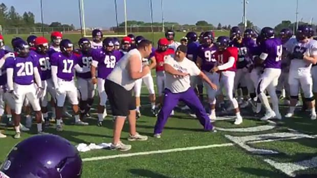 Holy Cross football coaches have WWE match--IMAGE