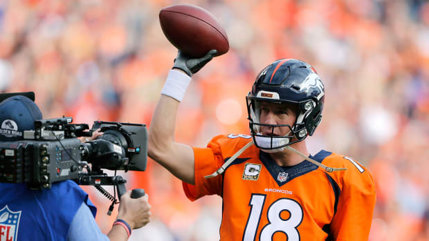 What does Manning's passing record mean in today's NFL? IMAGE