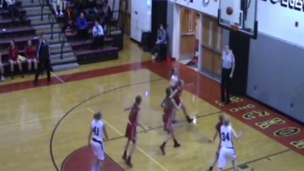 high school girl breaks rim free throw