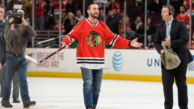 cm-punk-blackhawks-shoot-the-puck-nhl.jpg