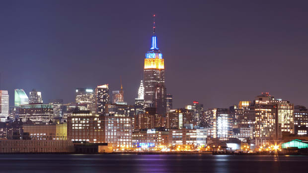 Empire State Building lit with NBA team colors