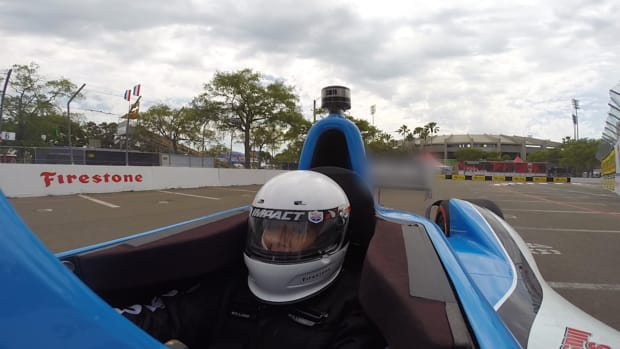Racing legend Mario Andretti takes SI Now's Maggie Gray for a spin in an IndyCar - Image