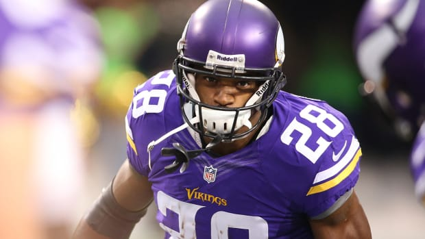 Agent: Not in Adrian Peterson's best interest to play for Vikings IMAGE