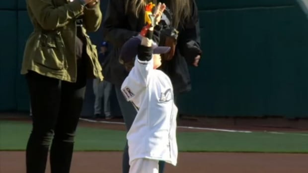 iron-man-prosthetic-hand-first-pitch.jpg