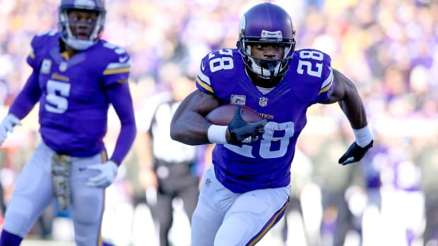 Vikings beat Rams to claim share of division lead IMAGE