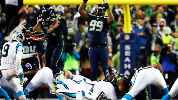 Watch: Kam Chancellor leaps Panthers' line twice for FG block attempt - image