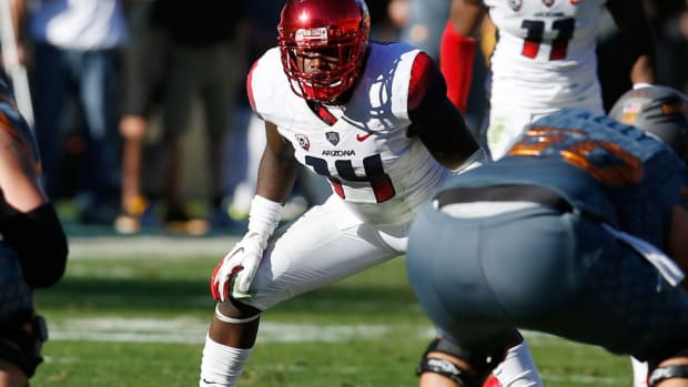 For an Arizona defense ravaged by injuries, Paul Magloire switches positions and keeps spirits high