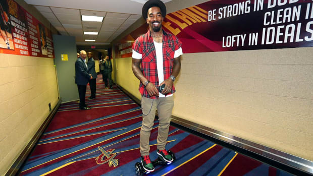 J.R. Smith arrives for Game 4 in style IMAGE