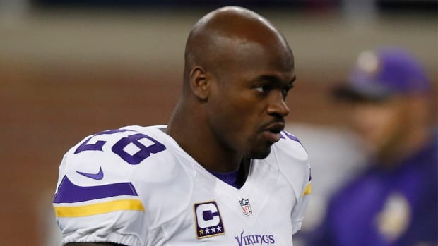 Minnesota Vikings RB Adrian Peterson plays despite illness-- IMAGE