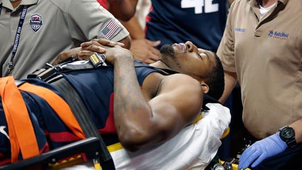 Paul George leg injury stretcher
