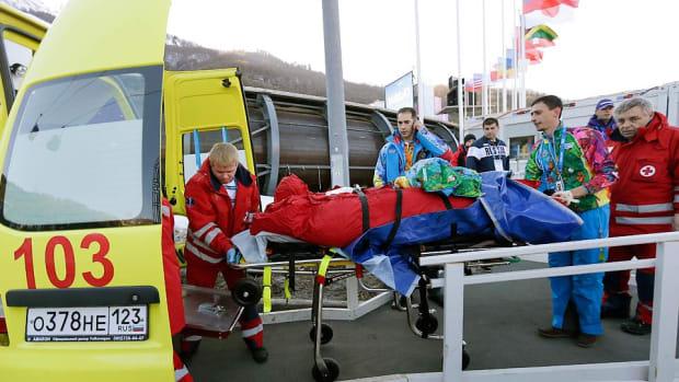 worker-hit-bobsled-sochi-olympics-02132014.jpg