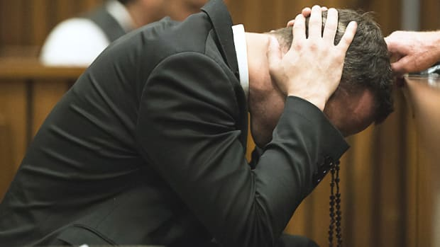 si/dam/assets/140306101410-oscar-pistorius-murder-trial-cover-ears-single-image-cut.jpg