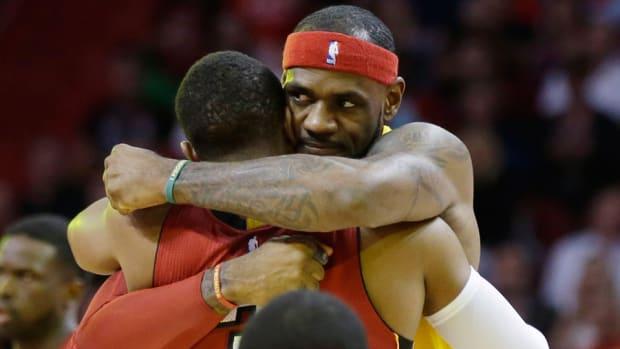 lebron james hugging dwyane wade