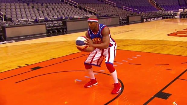 Harlem Globetrotter sets world record for longest backwards shot