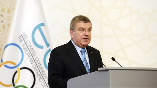 thomas bach 2022 winter olympics world cup clash