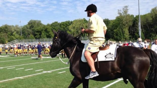 Notre Dame coach Brian Kelly rode a horse through practice