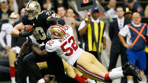 Jimmy Graham and Patrick Willis during a 2013 game