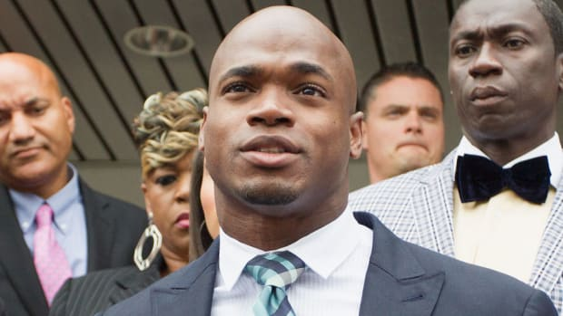 nike drops adrian peterson terminates contract