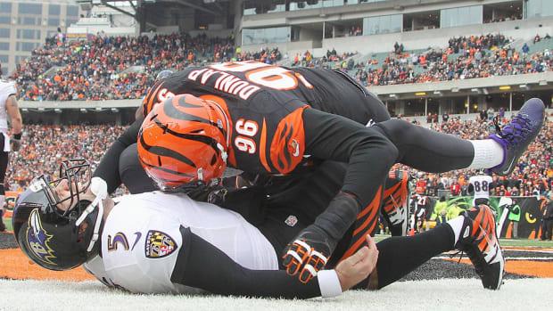 Carlos Dunlap hits Joe Flacco in a 2013 game
