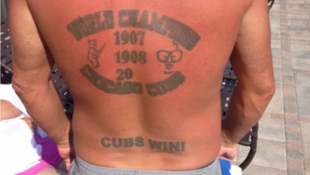 Chicago Cubs Fan gets clever world series tattoo