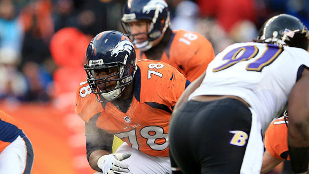 140425133813-denver-broncos-ryan-clady-peyton-manning-single-image-cut.jpg